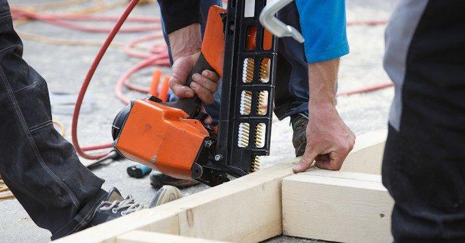 Carpenter building a stud wall