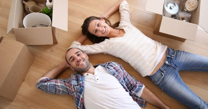 Young couple on the floor of their apartment