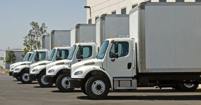 A row of delivery trucks